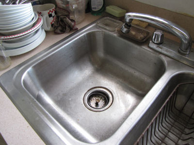 dingy stainless steel sink